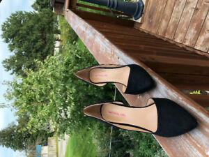 New black heels. Material girl. Size 7