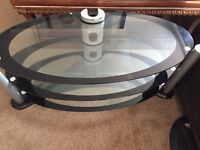 TV stand - black oval shaped glass