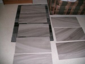 Large Ceramic Tiles: 12 x 24 in. Mix of marbled grey colors.