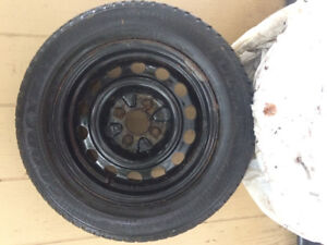 4 Winter Tires on steel Rims (Rims fit a Honda Civic or Acura)