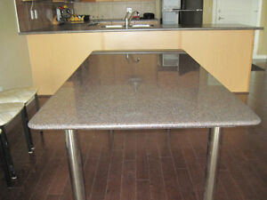 Granite table with 8 chairs