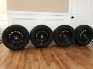 Four UNIROYAL 215/60 R16 winter tires with rims