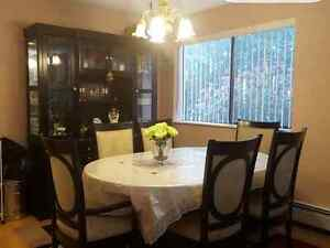 Dining table with 6 chairs and a hutch