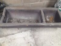 Glazed stone double cattle trough