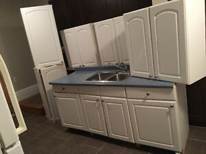 Mint condition lovely kitchen cabinets double sink set