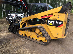 Professional skid steer services with Cat 289D track machine
