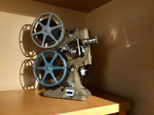 Vintage Movie projectors with reels make nice home theater props