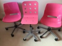Pink swivel chairs