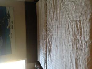 King size IKEA dark brown wicker bed