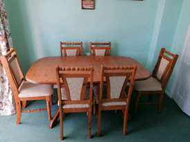 Solid wood oval dining table and 6 chairs