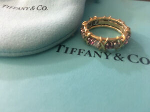 Tiffany & Co. Sixteen stone ring with diamond and pink sapphire