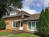 GREAT VALUE IN THIS BRICK HOME WITH LARGE LOT