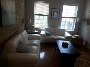 Two white genuine leather couches