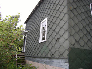 Arrow lock shingles or green asphalt roofing roll