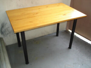 SOLID PINE TABLE WITH TUBULAR LEGS.