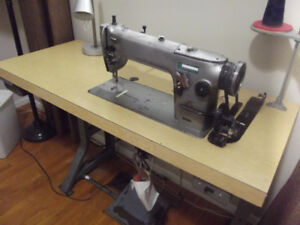 Industrial sewing machine with cabinet