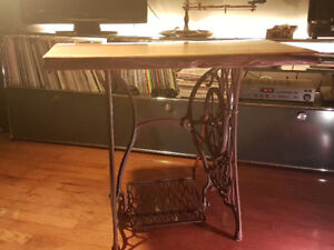 Victorian Era singer sewing machine with live edge oak table top