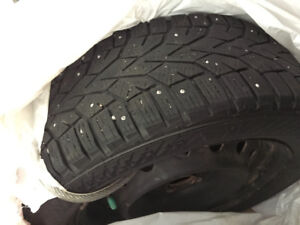 Studded Winter tires mounted on rims