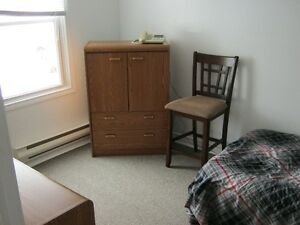 Semi-furnished room for rent by the airport