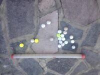 Golf balls and dispensing tube