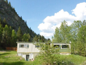 Older mobile on three 100x100 lots in Greenwood, BC, $78k only!