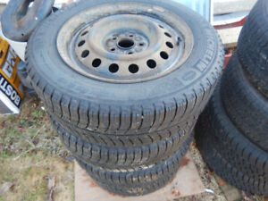 snow and mud steel radials on rim for mazda or ford half ton 965