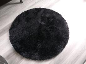 Large black fluffy rug