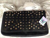 Black handbag with gold studs