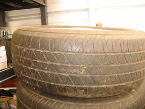 1 set of 4 tires and rims for caddy or GM.