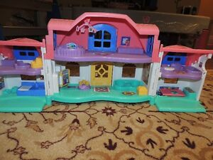 Several Fisher Price Little People playsets
