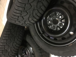 Set of winter tires and rims like new 205/55/16