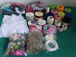 Craft supplies including felt, crochet yarn, flowers...