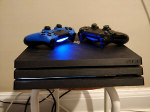 PS4 PRO with GAMES and 2 CONTROLLERS