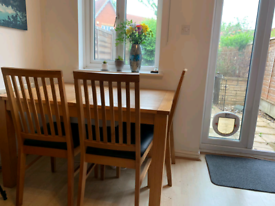 Wooden dining table with four chairs in great condition