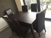 Extending table and 6 leather chairs
