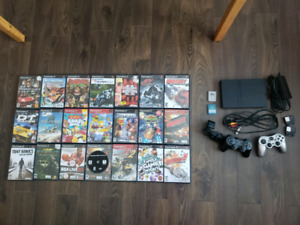 PS2 with accessories and games
