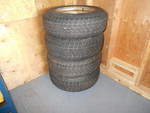 4 STUDDED WINTER TIRES  205/75/15