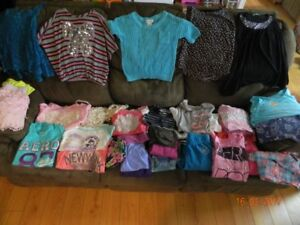 Over 60 pcs of girl's clothing size 10/12 and 14 and shoes.