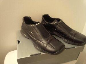 Authentic Prada unisex shoes .