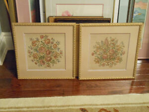 A matching pair of floral tapestries.