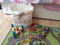 Toy storage basket with baby toys