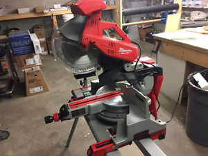 Milwaukee sliding mitre saw with stand!