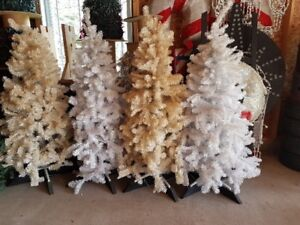 5 White artificial christmas trees