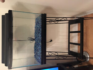 10 Gallon glass aquarium with stand and other accessories.