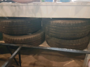 "4 15"" All season tires - P215/70R15 97T"