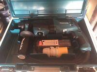 110v Mikita 2630 hammer action drill.