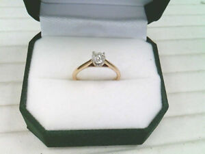 One Lady's 14k Yellow and White Gold and Diamond Solitaire Ring.