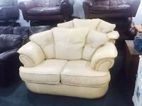 2 Peach leather 2 seater sofas and foot stool