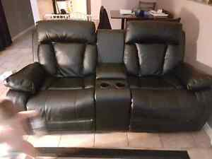 Like new black faux leather love seat and couch with recliners