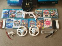MASSIVE Wii U Premium 32gb Bundle - guitar hero live, SKYLANDERS IMAGINATORS 11 games etc